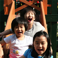 Pole pad kids laughing_home page